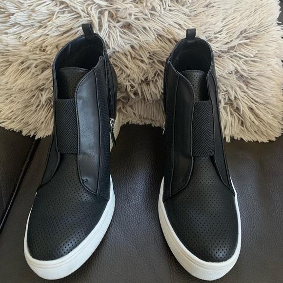 Black leather wedge sneaker